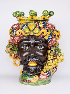 Testa porta pianta uomo moro con corona e frutta (H 44)