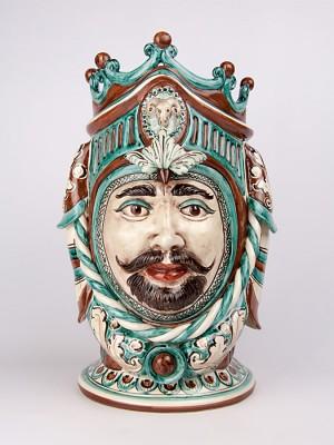 Testa porta pianta figura maschile con corona (H 42)